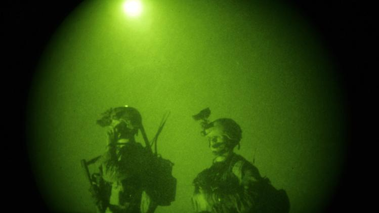 FILE - In this Oct. 28, 2008 file photo, taken with a night vision scope, U.S. Special Operations forces are seen during a joint operation with Afghan National Army soldiers targeting insurgents operating in Afghanistan's Farah province.  Small teams of U.S. special operations forces arrived at American embassies throughout North Africa to set up a new counterterrorist network months before militants killed the U.S. ambassador in Libya. But officials say the network was too new to stop the Benghazi attack.  (AP Photo/Maya Alleruzzo, File)