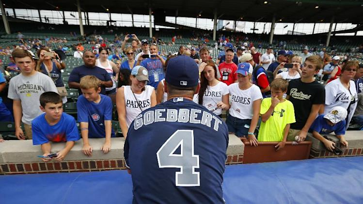 San Diego Padres first baseman Jake Goebbert (4) signs autographs at Wrigley Field before a baseball game against the Chicago Cub in Chicago, Tuesday, July 22, 2014. (AP Photo/Jeff Haynes)