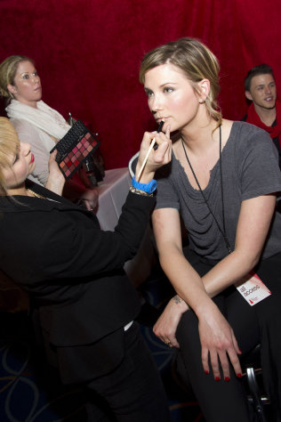 Singer Jennifer Nettles appears backstage at the Heart Truth&#39;s Red Dress Collection during Fashion Week in New York, Wednesday, Feb. 8, 2011. (AP Photo/Charles Sykes)