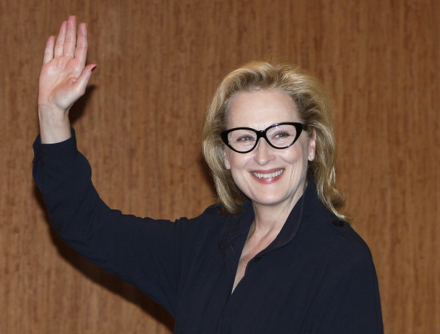 "FILE - In this March 7, 2012 file photo, Academy Award winning actress Meryl Streep waves during a press conference to promote their movie ""The Iron Lady"" in Tokyo, Japan. Kevin Kline will play Romeo opposite Meryl Streep's Juliet for a one-night-only staged reading of Shakespeare's play in Central Park. The Public Theater said Tuesday that Streep and Kline will combine on June 18 to help celebrate the 50th anniversary of its Shakespeare in the Park series. (AP Photo/Shizuo Kambayashi, file)"