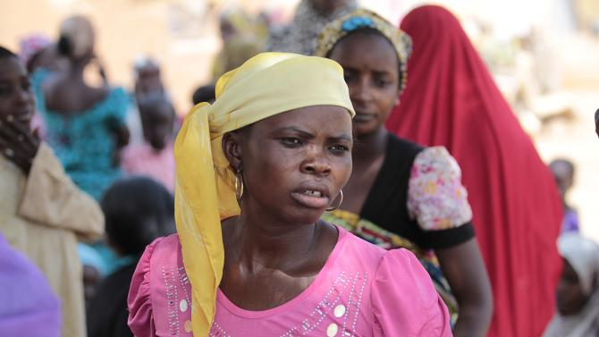 Women are seen at a camp for displaced people fleeing violence from Gulak
