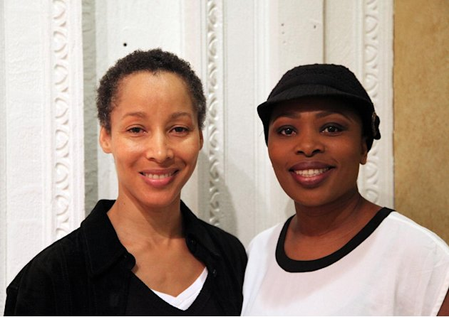"In this Nov. 8, 2012, photo, dancer Camille N. Brown, left, and singer Lindiwe Dlamini pose before a performance of ""The Lion King"" in New York. Both women have been in the ensemble of the Broadway hit show for its entire 15-year run. (AP Photo/Mark Kennedy)"