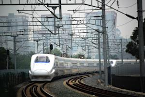 A high-speed train is on its way to Beijing, from Nanning, …