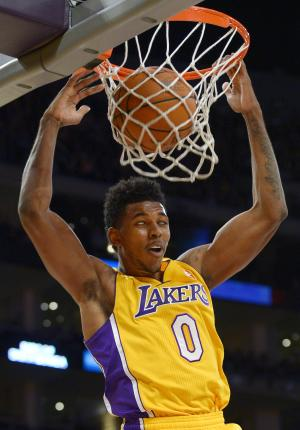 Los Angeles Lakers forward Nick Young dunks during the first half of an NBA basketball game against the Golden State Warriors, Friday, Nov. 22, 2013, in Los Angeles. (AP Photo/Mark J. Terrill)
