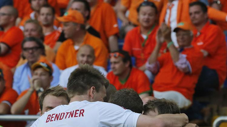 Danish players celebrate after their team scored during the Euro 2012 soccer championship Group B match between the Netherlands and Denmark in Kharkiv , Ukraine, Saturday, June 9, 2012. (AP Photo/Matthias Schrader)