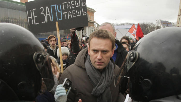 Russian investigators accuse Navalny of fraud