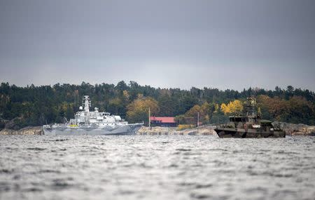 """The Swedish minesweeper HMS Kullen and a guard boat are seen in the search for suspected """"foreign underwater activity"""" at Namdo Bay, Stockholm"""