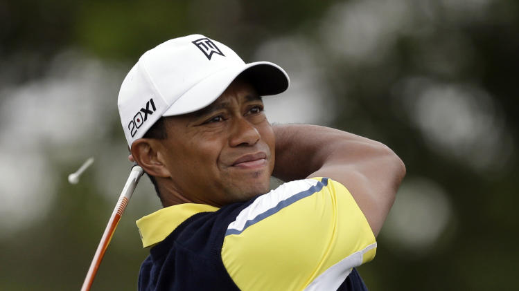 Tiger Woods hits off the 14th tee during the second round of the Honda Classic golf tournament on Friday, March 1, 2013, in Palm Beach Gardens, Fla. (AP Photo/Wilfredo Lee)