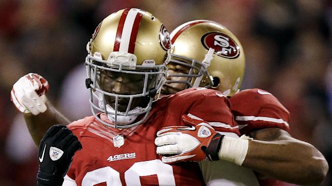 San Francisco 49ers linebacker Aldon Smith (99) is congratulated by linebacker Ahmad Brooks after sacking Chicago Bears quarterback Jason Campbell (2) during the third quarter of an NFL football game in San Francisco, Monday, Nov. 19, 2012. (AP Photo/Marcio Jose Sanchez)