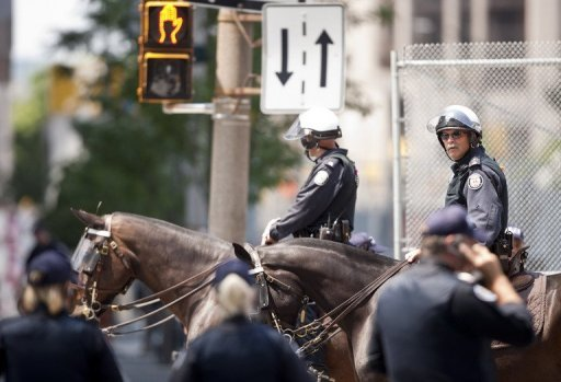 <p>File photo of police in downtown Toronto, Canada. Two people were killed and several including an infant were injured in a shooting in Canada's largest metropolis Toronto, police said.</p>