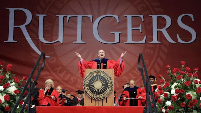 Rutgers University President Robert L. Barchi gestures to students in the rain at Rutgers University's football stadium in Piscataway, N.J., Sunday, May 19, 2013, during graduation ceremonies. (AP Photo/Mel Evans)