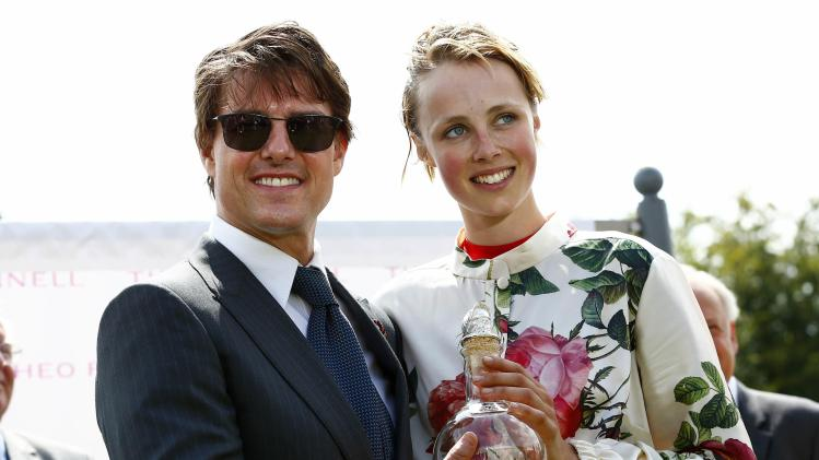 Hollywood actor Tom Cruise presents an award to supermodel Edie Campbell after she won a Ladies charity race at Goodwood racecourse