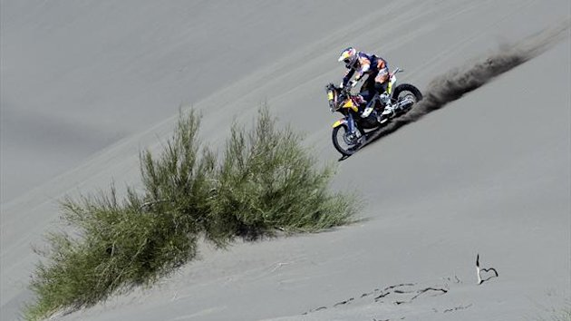 Spain's Marc Coma rides his KTM motorcycle during the Dakar Rally 2014 (Reuters)