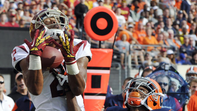 Southern California wide receiver Robert Woods, left, catches a touchdown pass over Syracuse cornerback Ri'Shard Anderson during the second quarter of an NCAA college football game Saturday, Sept. 8, 2012, in East Rutherford, N.J. (AP Photo/Bill Kostroun)