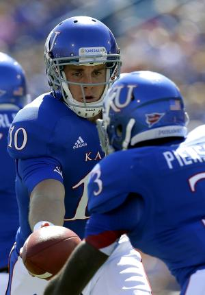 Kansas quarterback Dayne Crist (10) hands off the ball to running back Tony Pierson (3) during the first half of an NCAA college football game against Rice Saturday, Sept. 8, 2012, in Lawrence, Kan. (AP Photo/Charlie Riedel)