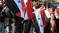 Syrians line the street for the funerals of 27 people killed in two bomb blasts in Damascus on March 18, 2012. An advance UN team preparing the deployment of observers in Syria is expected in Damascus within the next two days, the spokesman for UN-Arab League envoy Kofi Annan says