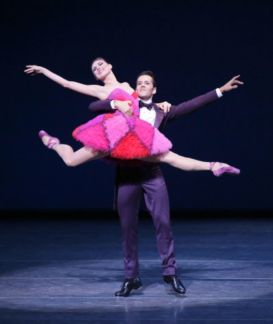 This Thursday, Sept. 20, 2012 image released by the New York City Ballet shows Tiler Peck, left, and Robert Fairchild performing in &quot;Not My Girl&quot; at the New York City Ballet fall gala, with costumes designed by Valentino Garavani in New York. (AP Photo/New York City Ballet, Paul Kolnik)