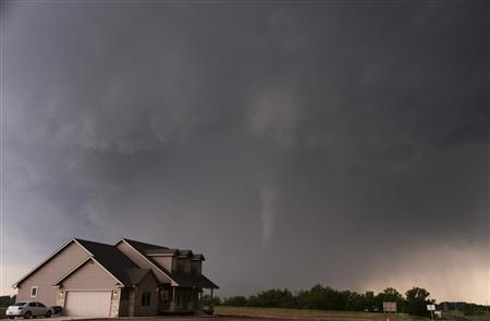 A tornado is pictured near a home in South Haven