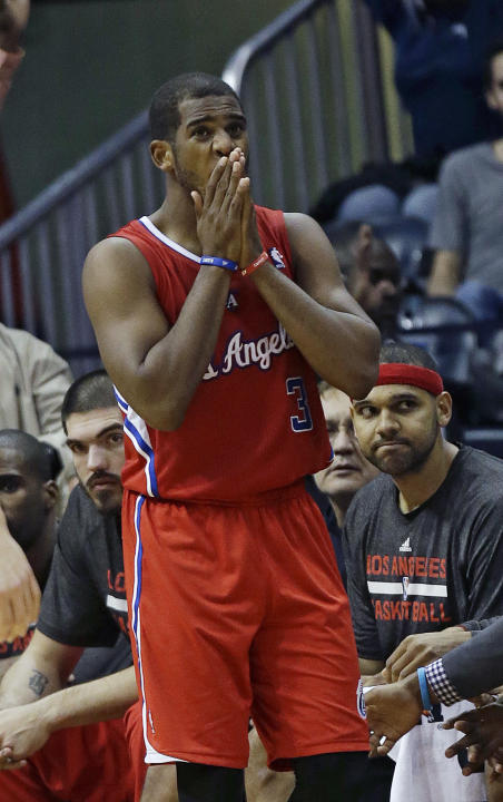 Los Angeles Clippers point guard Chris Paul (3) reacts after being charged with a foul late in the second half of an NBA  basketball game against the Atlanta Hawks Wednesday, Dec. 4, 2013, in Atlanta.