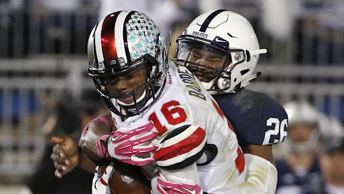 Penn State linebacker Brandon Bell (26) sacks Ohio State quarterback J.T. Barrett during the fourth quarter of an NCAA college football game in State College, Pa., Saturday, Oct. 25, 2014. Ohio State won in two overtimes, 31-24. (AP Photo/Gene J. Puskar)