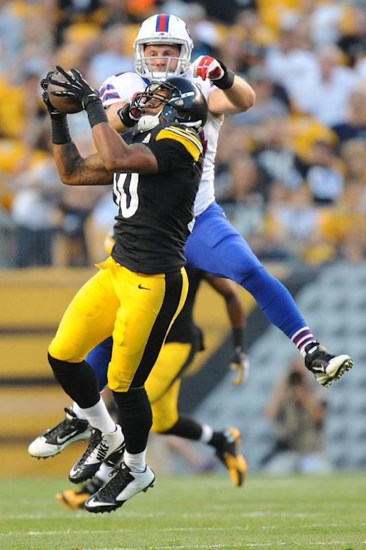 Pittsburgh Steelers outside linebacker Ryan Shazier (50) intercepts a pass intended for Buffalo Bills tight end Scott Chandler (84) in the first quarter of an NFL football preseason game on Saturday, Aug. 16, 2014, in Pittsburgh
