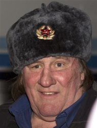Actor Gerard Depardieu wears a traditional Russian hat, also known as a Ushanka hat, during a welcoming ceremony at the airport in Grozny February 24, 2013. REUTERS/Rasul Yarichev