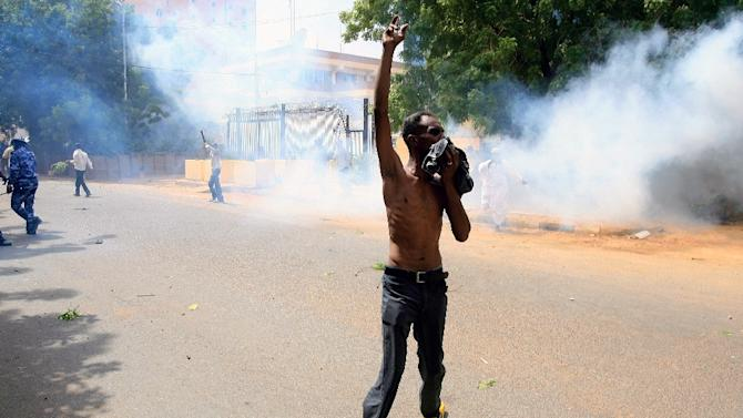 A Sudanese demonstrator gestures during a protest in Khartoum