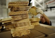 A worker at Streits Matzo factory on the lower east side of New York stacks matzo wafers