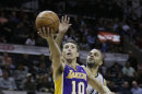 Los Angeles Lakers' Steve Nash (10) drives to the basket as San Antonio Spurs' Tony Parker, right, of France, defends him during the second half of Game 2 of a first-round NBA basketball playoff series, Wednesday, April 24, 2013, in San Antonio, Texas. San Antonio won 102-91. (AP Photo/Eric Gay)
