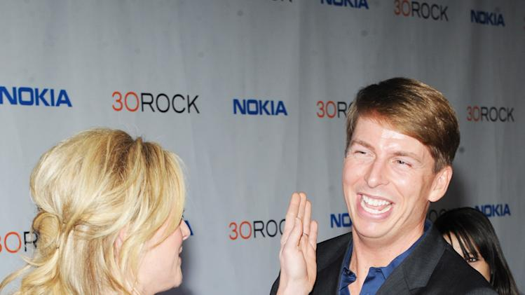 "Jane Krakowski, left, and Jack McBrayer attends the Nokia ""30 Rock"" wrap party on Thursday, Dec. 20, 2012 in New York. (Photo by Scott Gries for Nokia/AP Images)"