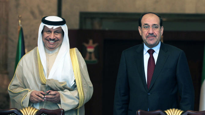 Iraqi Prime Minister Nouri al-Maliki, right, and his Kuwait counterpart Sheikh Jaber Al Mubarak Al Hamad Al Sabah, left, attend a signing ceremony in Baghdad, Iraq, Wednesday, June 12, 2013. Kuwait's prime minister has arrived in Baghdad on an official visit, signaling the improving ties between the two neighbors.  Officials later signed a series of agreements aimed at improving bilateral ties in the economic, transportation and other sectors. (AP Photo/ Karim Kadim, Pool)
