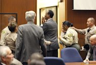 Dr. Conrad Murray blows a kiss to an unidentified member of the courtroom audience after he was sentenced to four years in county jail for his involuntary manslaughter conviction in the death of pop star Michael Jackson, on Tuesday, Nov. 29, 2011 in Superior Court in Los Angeles. (AP Photo/Mario Anzuoni, Pool)