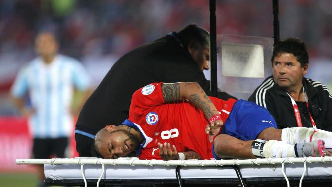 Chile's Arturo Vidal is taken off the pitch on a stretcher after being injured during their Copa America 2015 final soccer match against Argentina at the National Stadium in Santiago