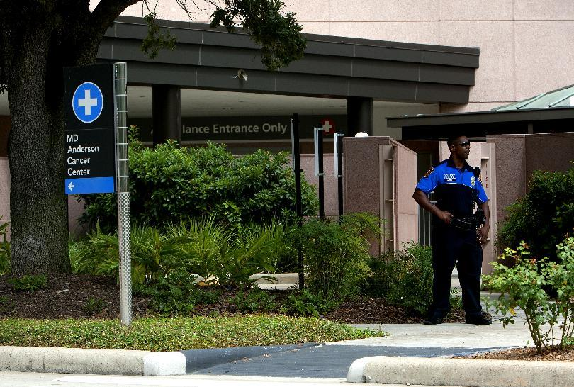 A police officer stands in front of the MD Anderson Cancer Center where Vice President Joe Biden reportedly entered, Tuesday, Aug. 20, 2013, in Houston. Biden entered the hospital to support his son who sought medical attention at the hospital. (AP Photo/Houston Chronicle, Cody Duty) Mandatory Credit
