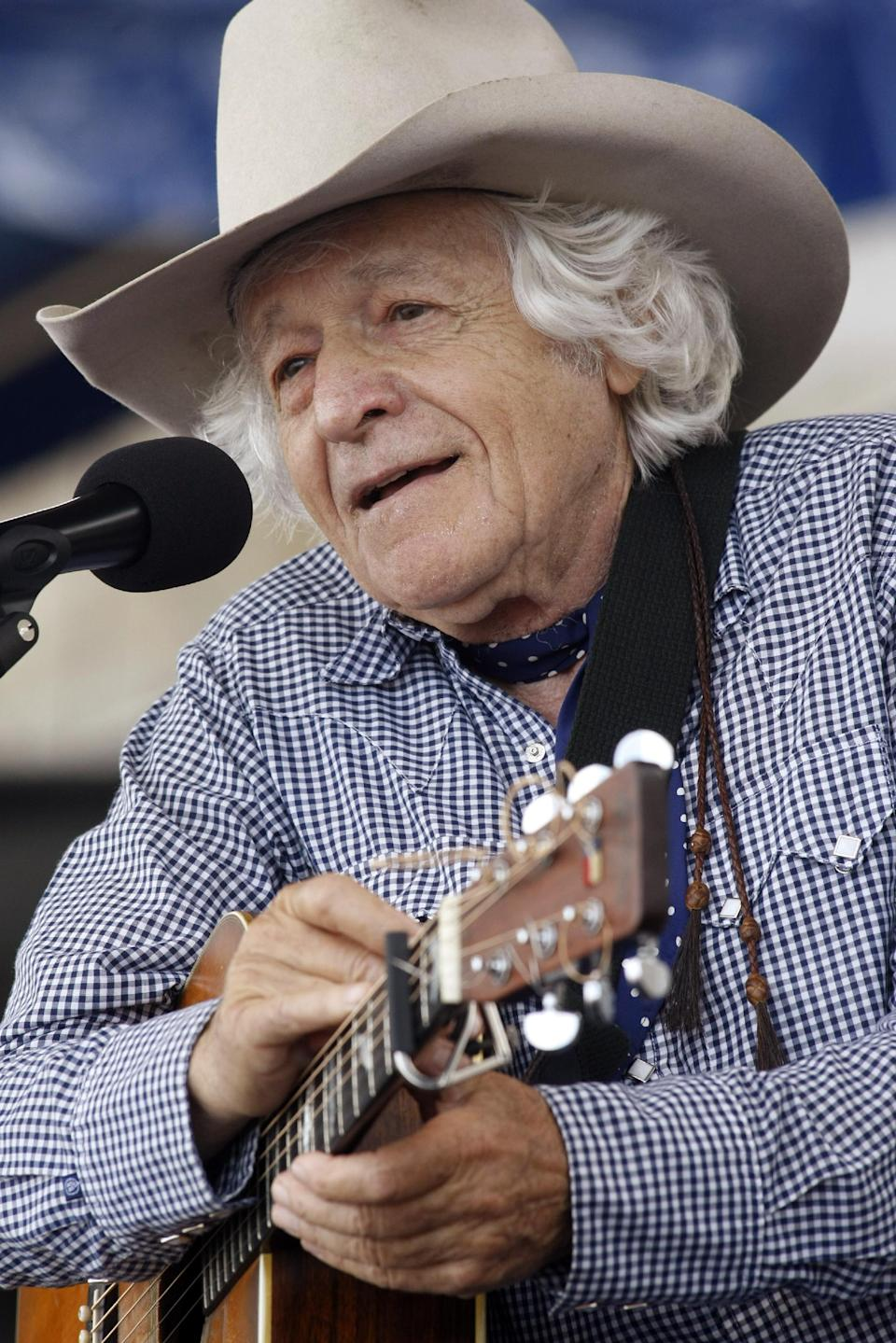 Ramblin' Jack Elliott performs at the 54th edition of the Newport Folk Festival in Newport, R.I., on Sunday, July 28, 2013. (AP Photo/Joe Giblin)