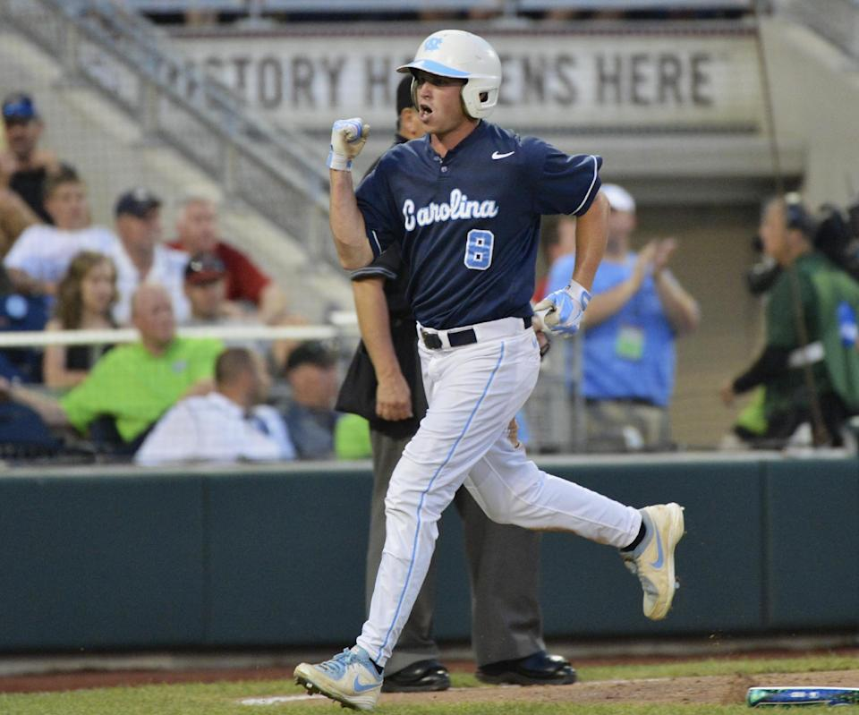 North Carolina's Parks Jordan celebrates after scoring against North Carolina State on a single by Colin Moran in the fifth inning of an NCAA College World Series elimination baseball game in Omaha, Neb., Thursday, June 20, 2013. (AP Photo/Ted Kirk)