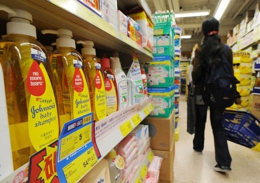 <p>Johnson's Baby Shampoo is displayed at a supermarket in Hong Kong, 2009. Second quarter earnings fell by half to $1.41 billion at pharmaceuticals giant Johnson & Johnson after it took more than $2.0 billion in special charges and writeoffs, the company said Tuesday.</p>