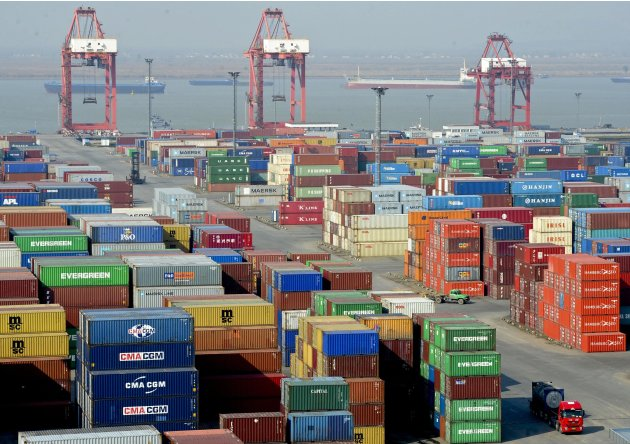 In this photo taken on Saturday, Dec. 10, 2011, a truck leaves a port in Nanjing in east China's Jiangsu province. During a forum to commemorate the 10-year anniversary of China's accession to the Wor