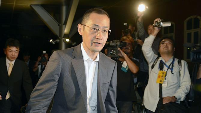 Professor Shinya Yamanaka arrives at Kyoto University for a news conference in Kyoto, western Japan Monday, Oct. 8, 2012, after the announcement in Stockholm by Nobel Prize committee.  British researcher John Gurdon and Yamanaka of Japan won this year's Nobel Prize in physiology or medicine on Monday for discovering that mature, specialized cells of the body can be reprogrammed into stem cells - a discovery that scientists hope to turn into new treatments. (AP Photo/Kyodo News) JAPAN OUT, MANDATORY CREDIT, NO LICENSING IN CHINA, FRANCE, HONG KONG, JAPAN AND SOUTH KOREA