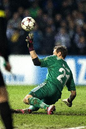 FC Copenhagen's goalkeeper Johan Wiland saves a penalty from Real Madrid's Christiano Ronaldo, during the Champions League, Group B, soccer match between FC Copenhagen and Real Madrid, at Park