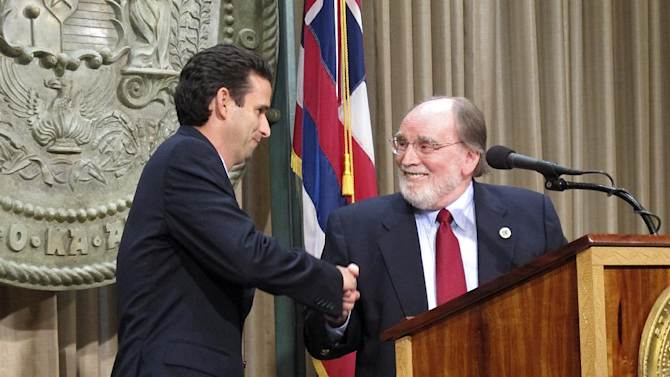 Hawaii Lt. Gov. Brian Schatz, left, shakes hands with Gov. Neil Abercrombie at the state Capitol in Honolulu on Wednesday, Dec. 26. 2012 after the governor announced he was appointing Schatz to fill the seat vacated by the late U.S. Sen. Daniel Inouye. (AP Photo/Audrey McAvoy)