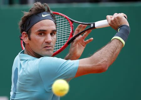 Roger Federer of Switzerland returns the ball to Gael Monfils of France during their match at the Monte Carlo Masters in Monaco