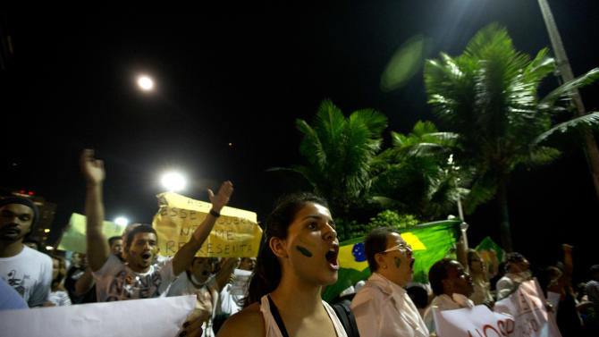 People march during an anti-government protest at Ipanema beach, in Rio de Janeiro, Brazil, Friday, June 21, 2013. Demonstrations began as an outcry against a 10-cent hike in bus and subway fares in Brazil's largest cities, but have continued even after announcements that the increases would be rescinded. Protesters have expressed frustration with corruption and what they say are high taxes and poor public services. They've demanded everything from education reforms to free bus fares while denouncing the billions of public dollars spent on stadiums before the World Cup and the Olympics. (AP Photo/Silvia Izquierdo)