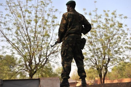 &lt;p&gt;A Malian soldier stands guard at Kati military camp near Bamako. The UN Security Council called for an immediate ceasefire and return to democracy in Mali, prompting an announcement of an end to &quot;military operations&quot; by Tuareg rebels in the north.&lt;/p&gt;