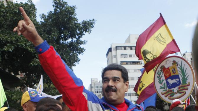 Venezuela's President Nicolas Maduro (R) greets supporters during a rally to commemorate the 26th anniversary of the social uprising known as 'Caracazo', which Venezuela's late President Hugo Chavez said marked the start of his revolution, in this Caracas