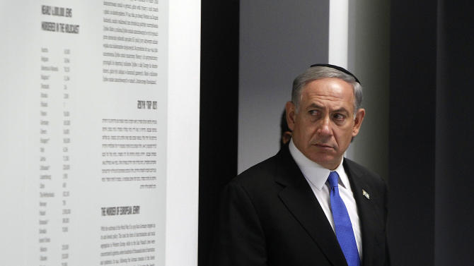 Israeli Prime Minister Benjamin Netanyahu visits an exhibition during the opening of a new pavilion at the former Nazi German death camp of Auschwitz, in Oswiecim, Poland, Thursday, June 13, 2013. The exhibition in Bloc 27 was curated by Israel's Yad Vashem Institute Chairman Avner Shalev. It is meant to educate visitors about the Holocaust and the Nazi Germany's quest to exterminate the Jewish people.The event closed Netanyahu's two-day visit to Poland that was steeped in symbolism, as it focused on the Jewish people's painful history there during World War II as well as on the strong relations between Poland and the Jewish state today. (AP Photo/Czarek Sokolowski)