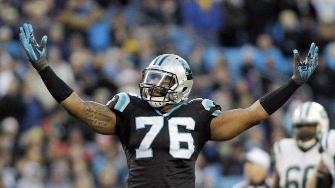 Carolina Panthers' Greg Hardy (76) celebrates after a sack against the New York Jets during the first half of an NFL football game in Charlotte, N.C., Sunday, Dec. 15, 2013