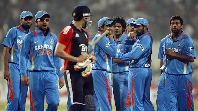 England's batsman Craig Kieswetter, third left, exchange words with Indian players after his dismissal during their Twenty20 international cricket match in Kolkata, India, Saturday, Oct. 29, 2011. (AP Photo/Aijaz Rahi)