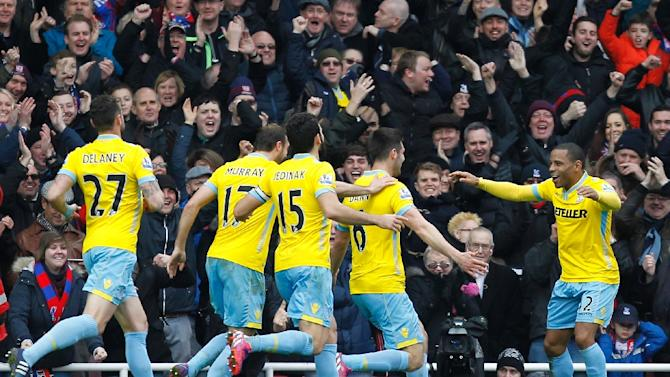 Crystal Palace defender Scott Dann (2nd R) celebrates with teammates after scoring during the Premier League match against West Ham United at Boleyn Ground in Upton Park in east London on February 28, 2015