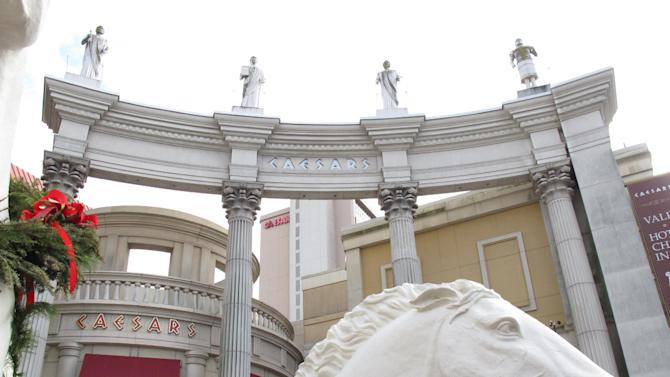 This photo taken on Dec. 9, 2011 shows the exterior of Caesars Atlantic City. The casino's parent company, Caesars Entertainment, warns investors that Internet gambling, begun in New Jersey two weeks ago, might hurt the company by reducing visits to and spending at its brick-and-mortar casinos. (AP Photo/Wayne Parry)